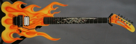 flaming-guitar-c36581cd3aa48bf16be5442ddeeb98f7a099f114